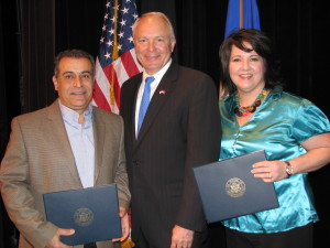 "Gaby Accad (left) and Jennifer Gouette (right) received ""Star of the North"" Congressional Awards from Congressman John Kline (center)"
